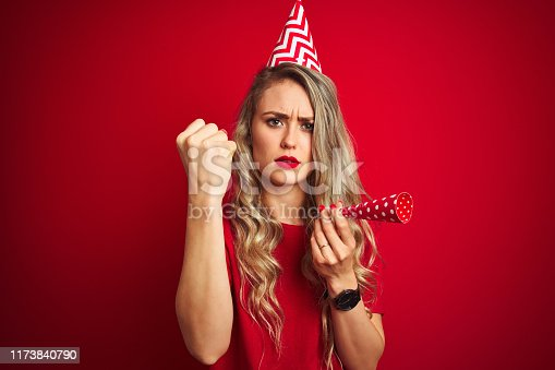 808681534 istock photo Young beautiful woman on birthday celebration over red isolated background annoyed and frustrated shouting with anger, crazy and yelling with raised hand, anger concept 1173840790