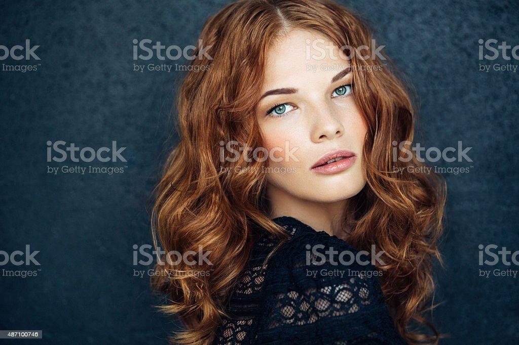 Young beautiful woman on dark background stock photo