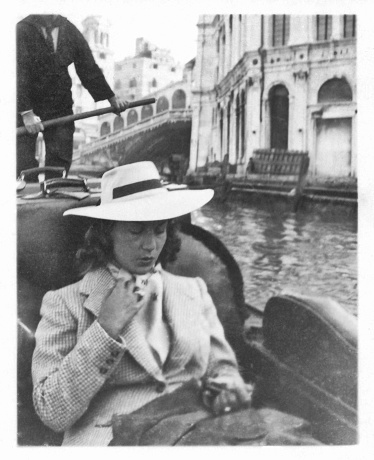 Young beautiful woman on gondola in Venice in 1941