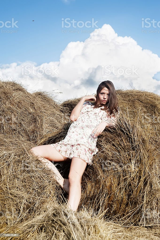 Young beautiful woman on hay royalty-free stock photo