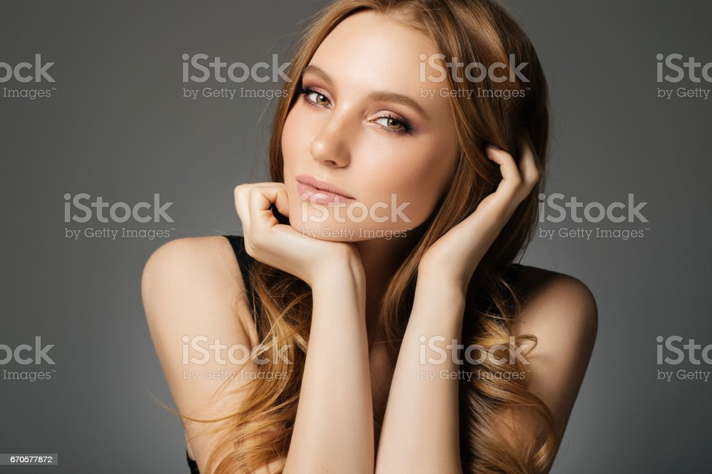 Young beautiful woman on light background stock photo