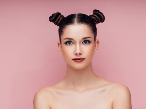 young beautiful woman - pigtails stock photos and pictures