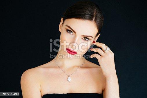 Studio shot of young beautiful woman. Professional make up