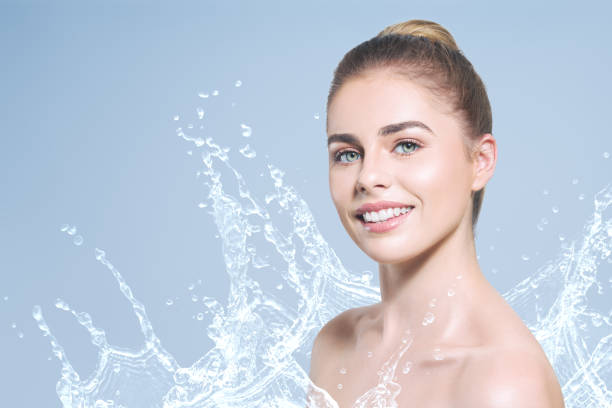 Young beautiful woman portrait with water splash