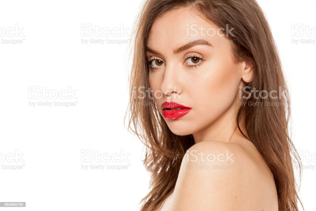 Young beautiful woman posing with red lipstick on her lips, on white background royalty-free stock photo