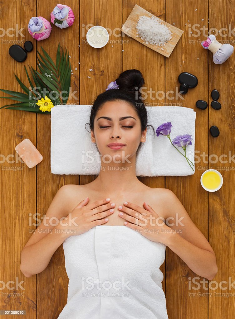 Young beautiful woman relax in aroma spa wellness center stock photo