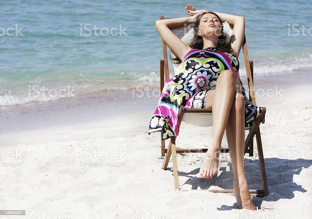 young beautiful woman relaxing on beach royalty-free stock photo