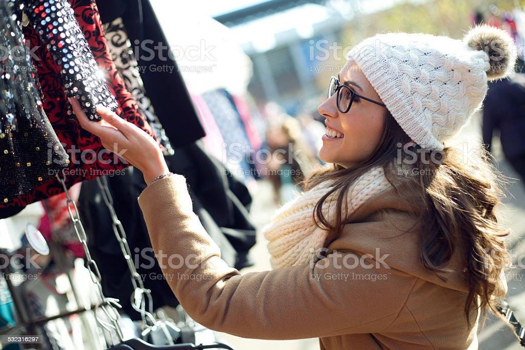 Young beautiful woman shopping in a market. stock photo