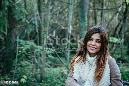 Young hiker resting in a walk in the woods.