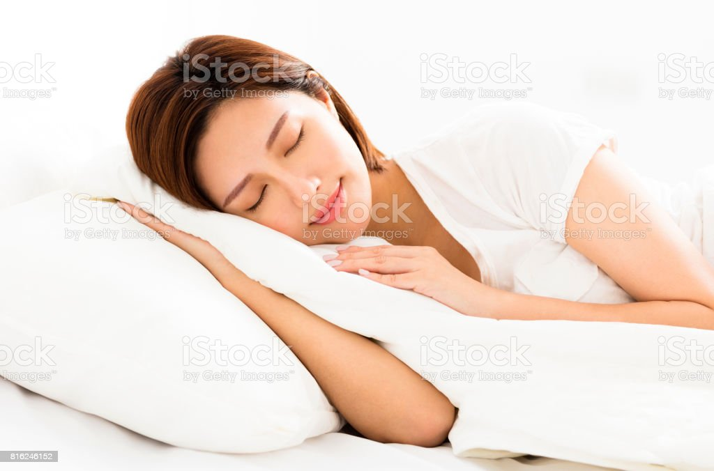 young beautiful woman sleeping in the bed stock photo
