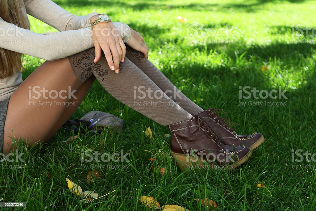 young beautiful woman slender legs in leather brown boots stock photo