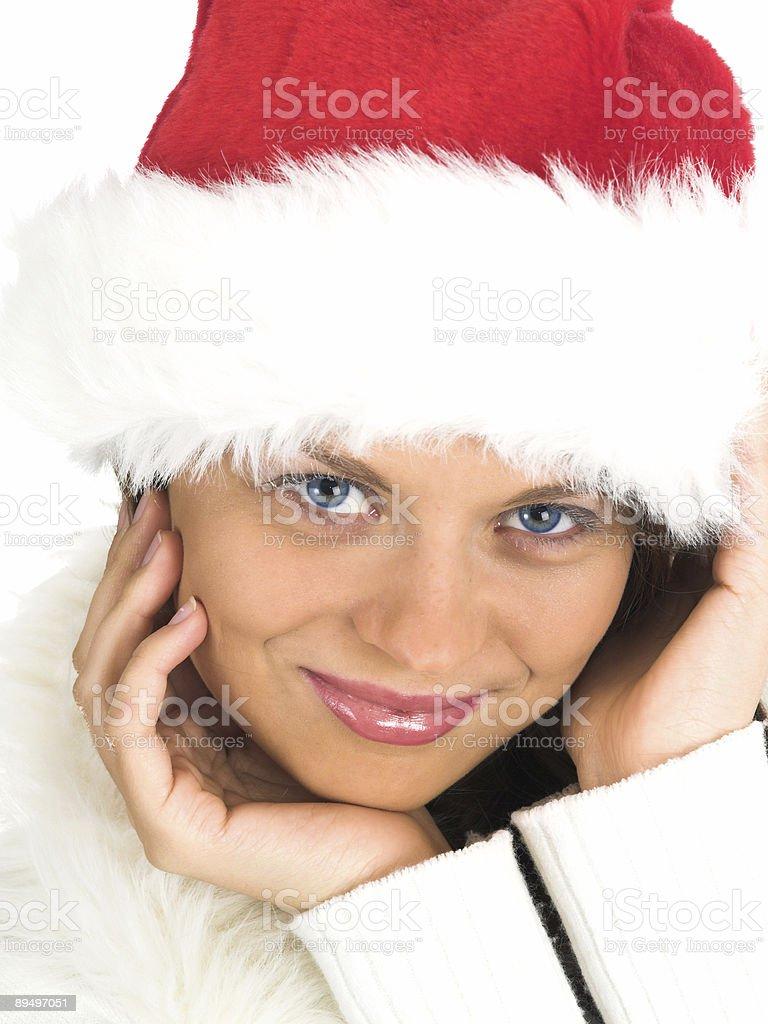Giovane bella donna sorridente in santa Cappello di foto stock royalty-free