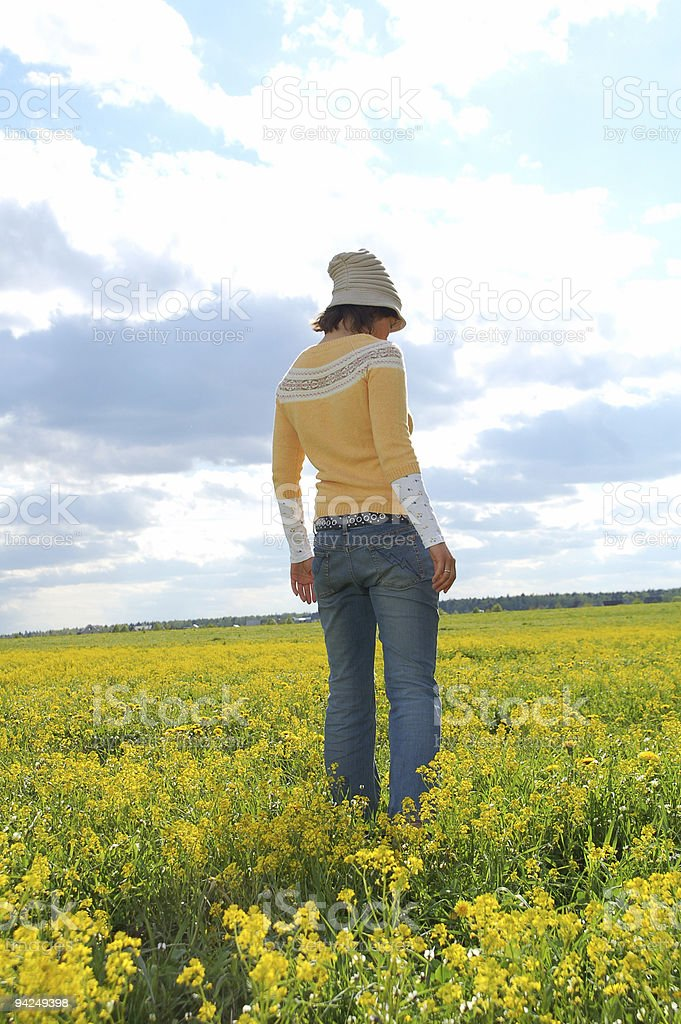 young beautiful woman standing at field royalty-free stock photo