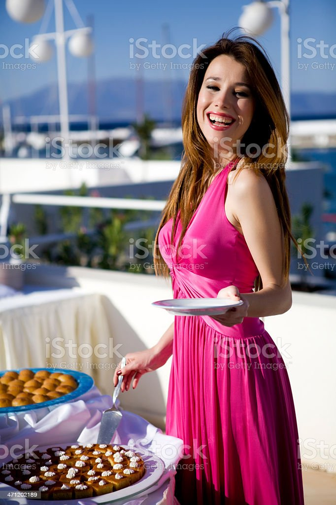 Young beautiful woman taking dessert royalty-free stock photo