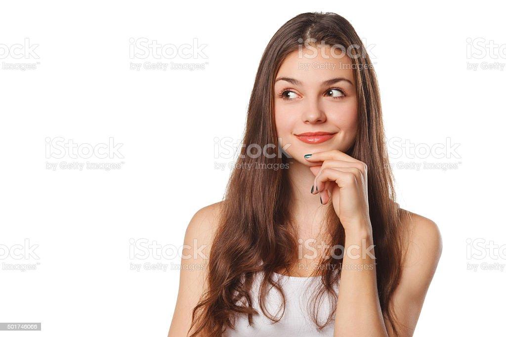Jeune belle femme pensant à la recherche sur le côté, isolation - Photo