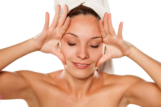 young beautiful woman tightens her face with her hands young beautiful woman tightens her face with her hands tighten stock pictures, royalty-free photos & images