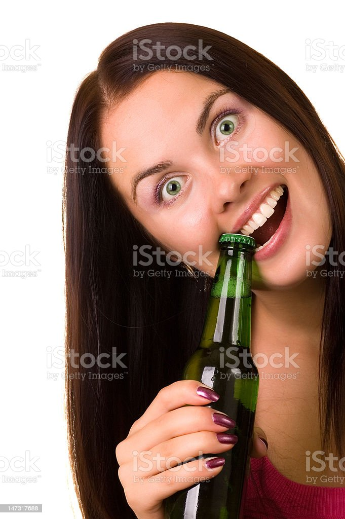 Young beautiful woman trying to open a bottle of beer stock photo
