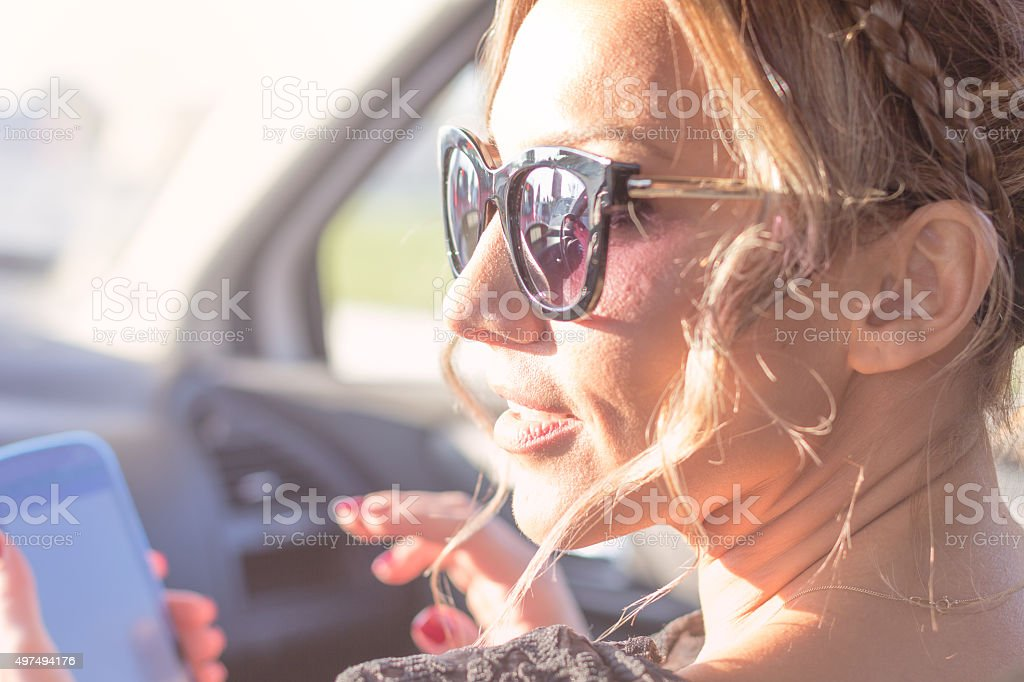 young beautiful woman uses phone stock photo