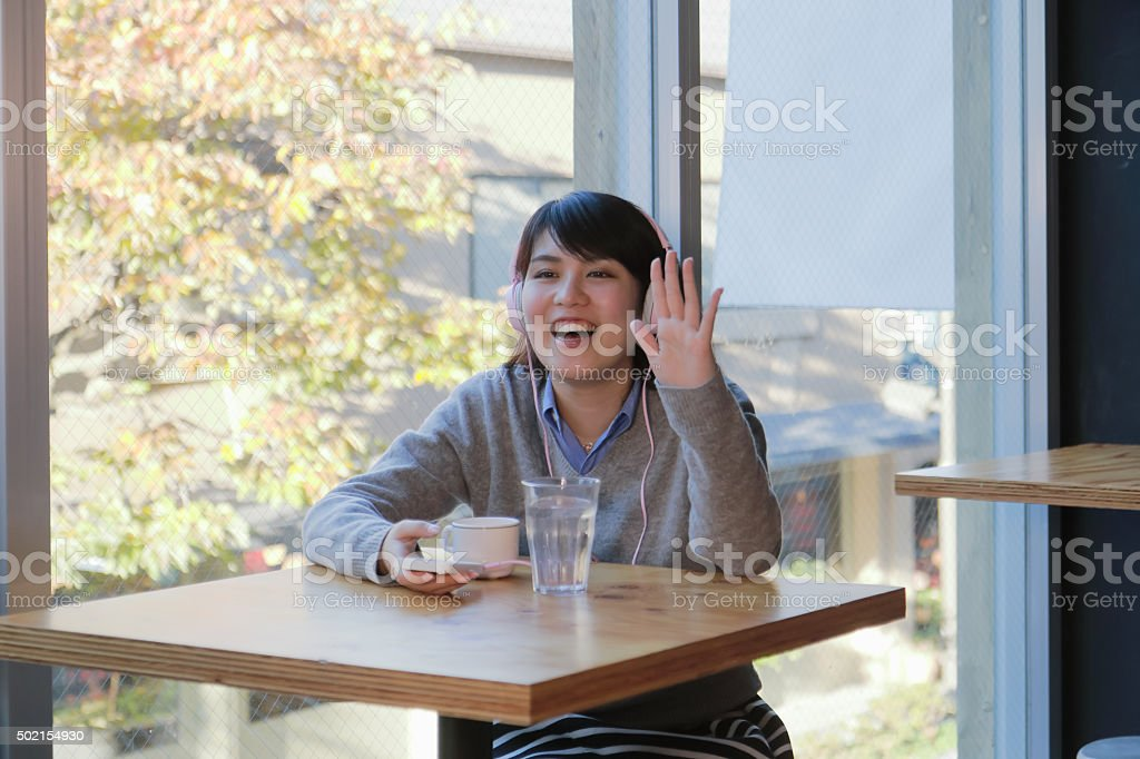 Young beautiful woman waiting on cafe table stock photo