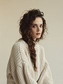 Portrait of young beautiful woman wearing beige sweater