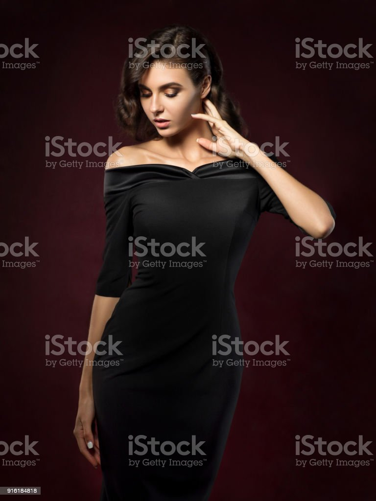 Young beautiful woman wearing black evening dress stock photo