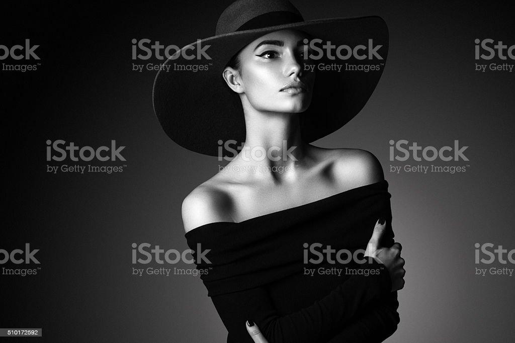 Young beautiful woman wearing black hat stock photo fashion