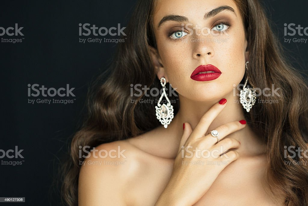 Young beautiful woman wearing earings haute couture stock photo