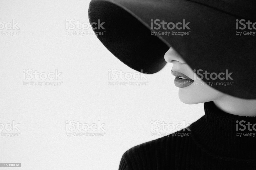 Young beautiful woman wearing hat stock photo