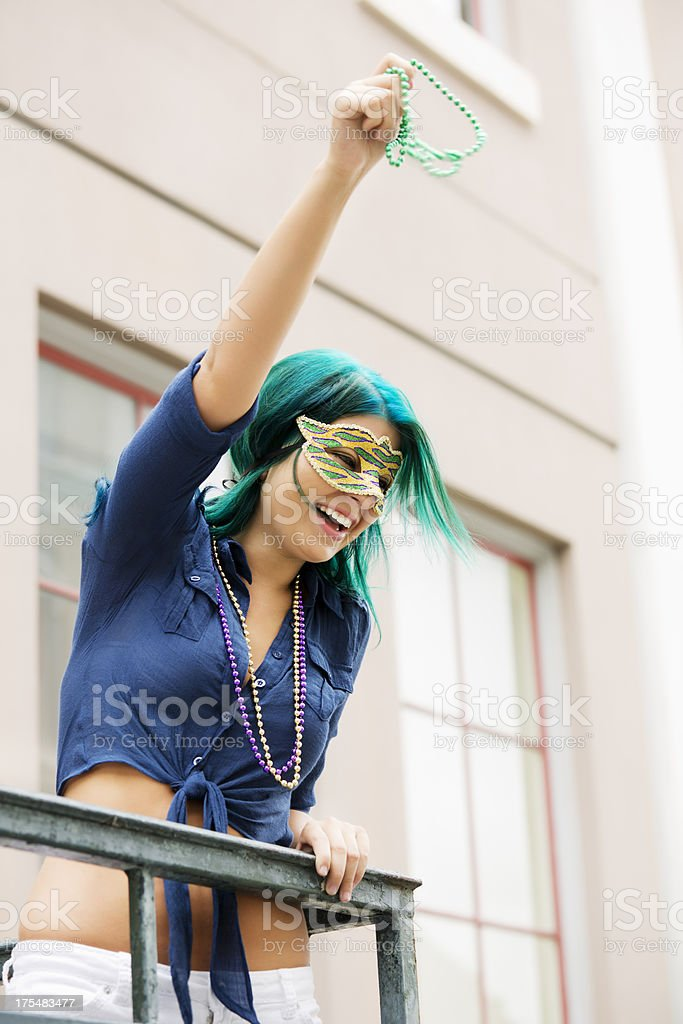 Young beautiful woman wearing mask in New Orleans stock photo