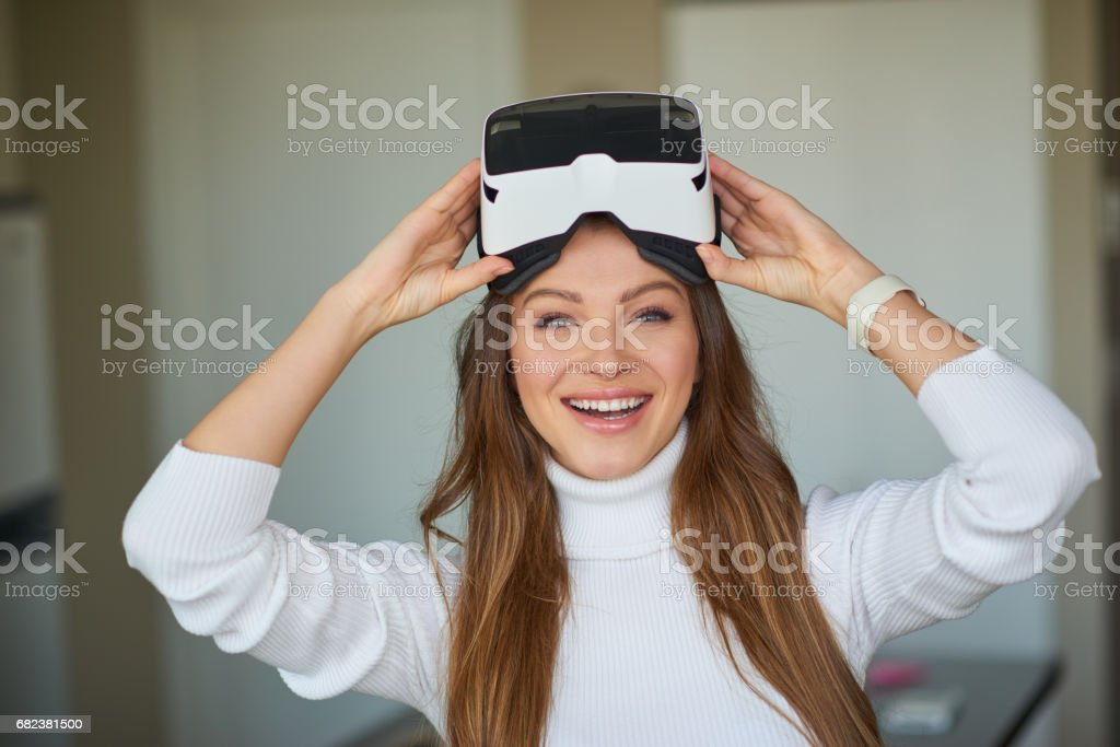 Young beautiful woman weating virtual reality glasses royalty-free stock photo