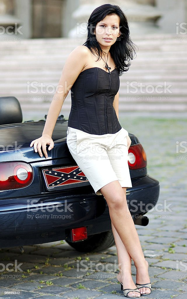 Young beautiful woman with a car royalty-free stock photo