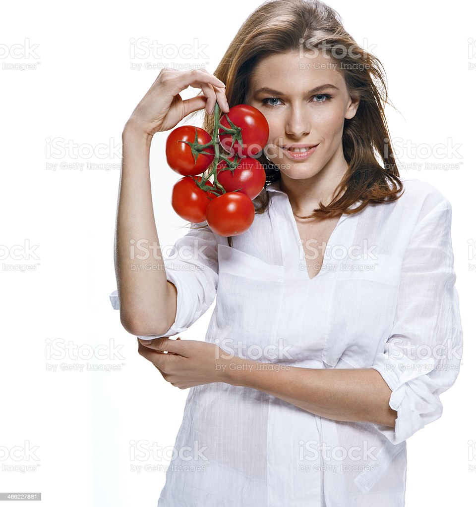 Young beautiful woman with bunch of tomatoes in hand isolated stock photo