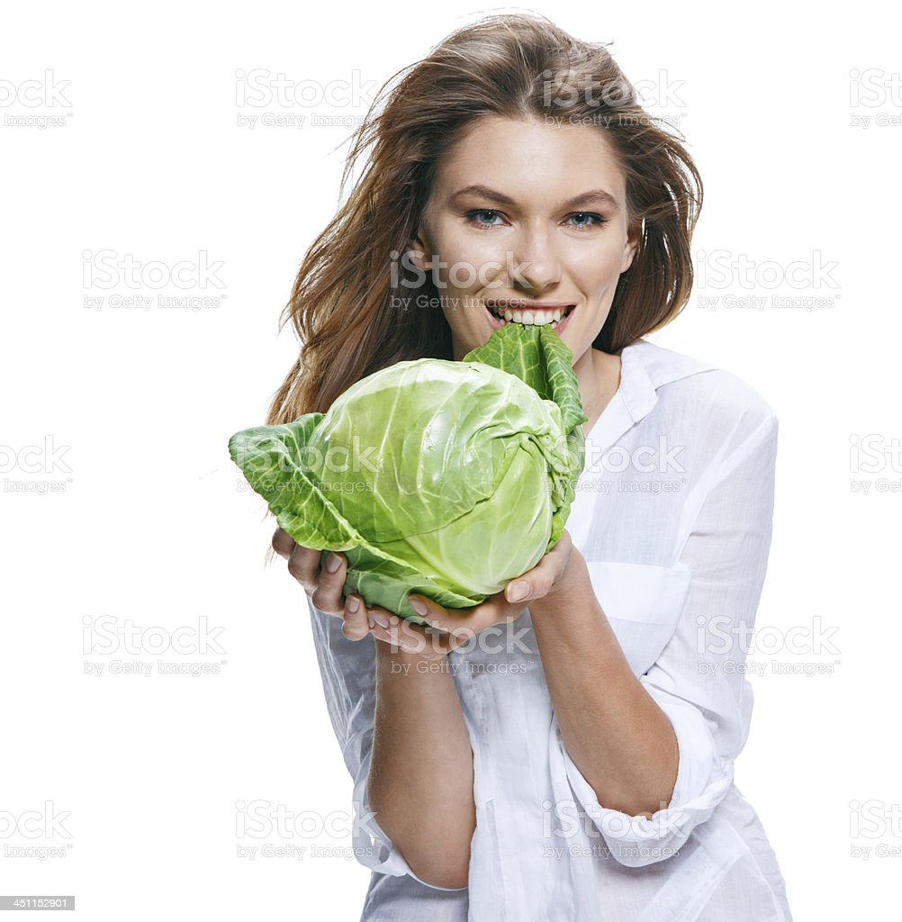 Young beautiful woman with cabbagehead in hand isolated stock photo