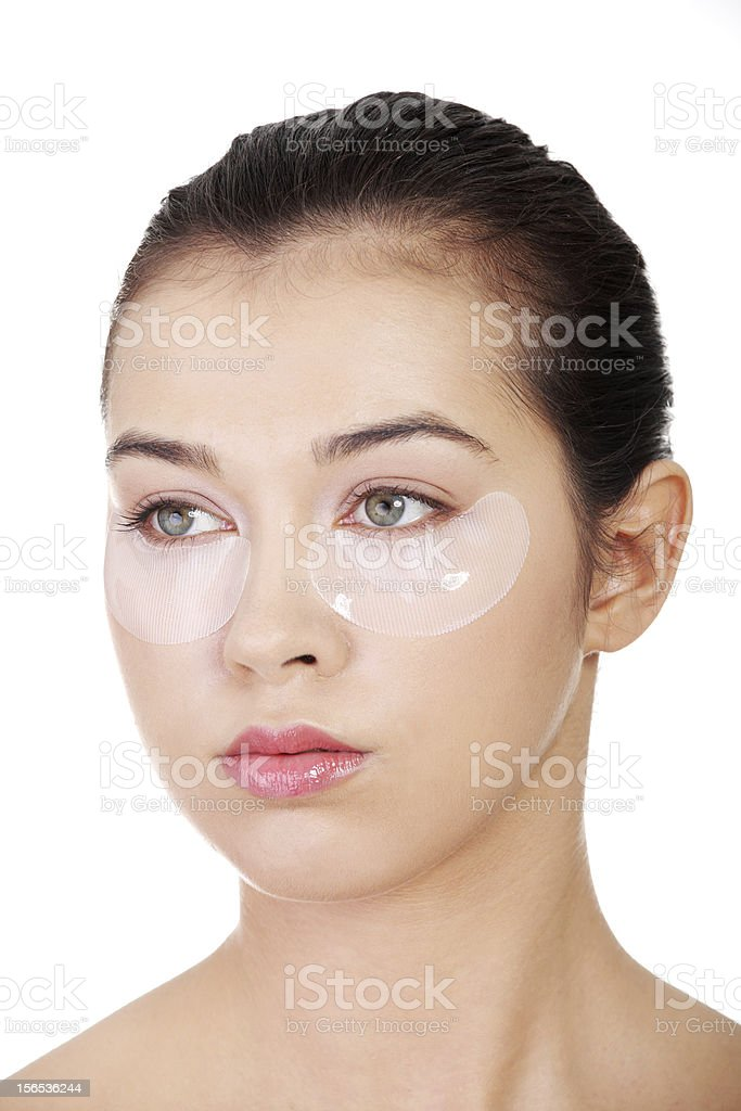 Young beautiful woman with collagen eye lift mask royalty-free stock photo