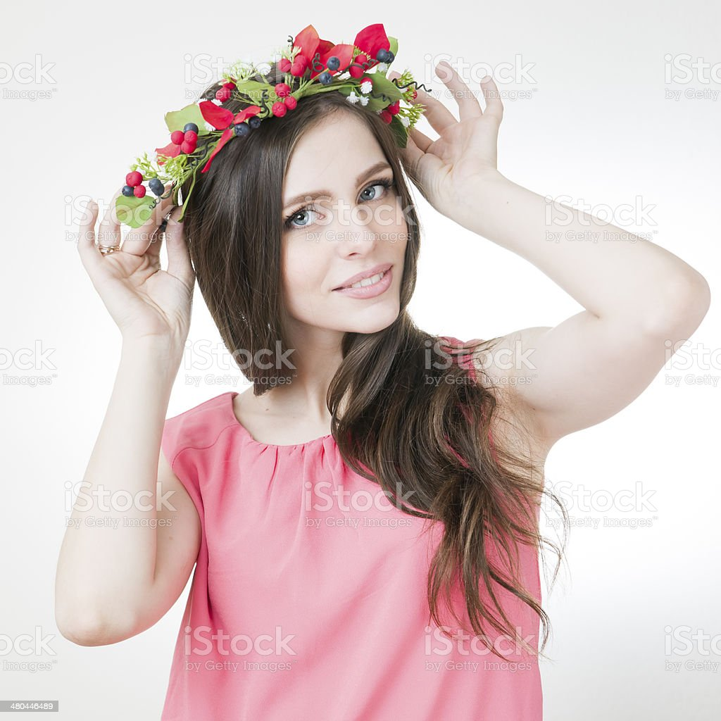 Young beautiful woman with flower wreath on head stock photo more young beautiful woman with flower wreath on head royalty free stock photo izmirmasajfo