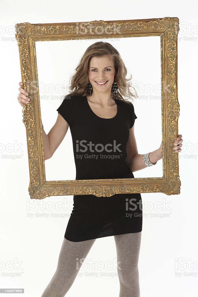 Young beautiful woman with frame royalty-free stock photo