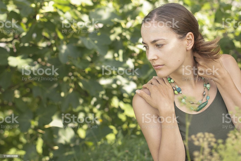 Young Beautiful Woman with Green Necklace royalty-free stock photo