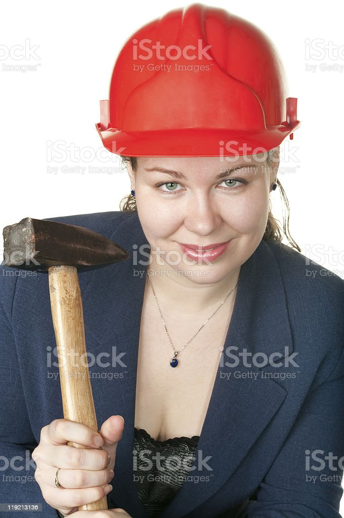 Young beautiful woman with hammer and in red hard hat. royalty-free stock photo
