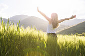 istock young beautiful woman with hands raised in the wheat field 537742063