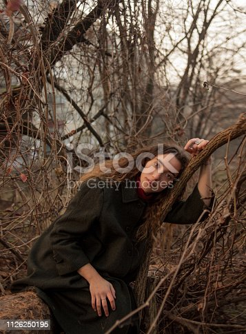 873786782istockphoto Young beautiful woman with long curly hair 1126250195