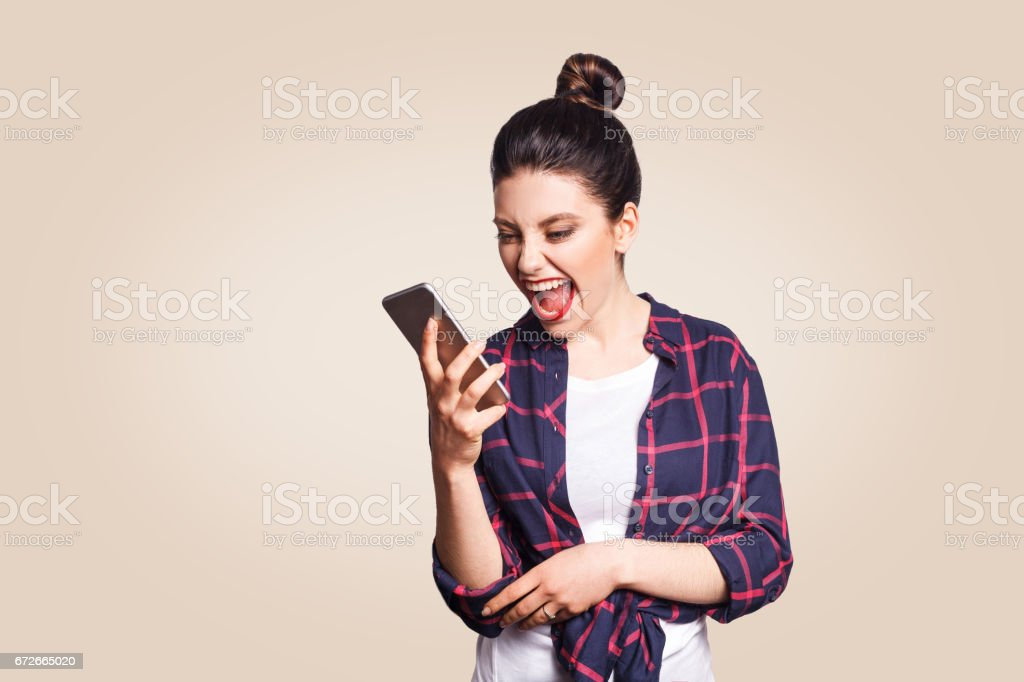 Young beautiful woman with mobile phone. stock photo