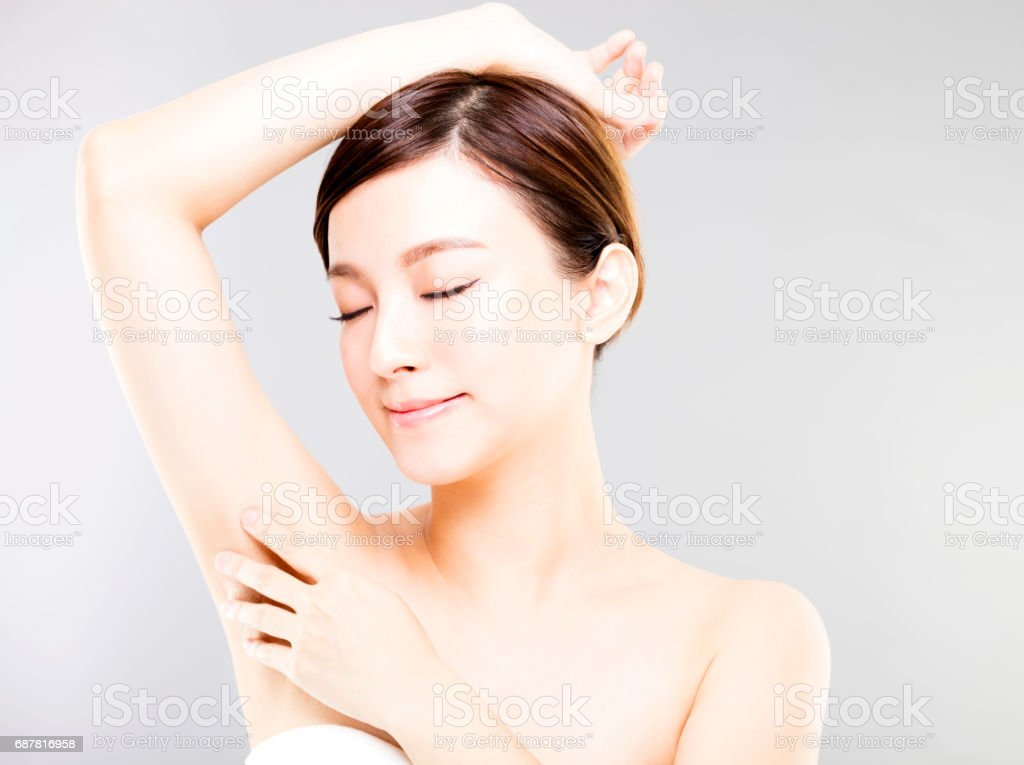 Young beautiful woman with perfect skin and armpit's care stock photo