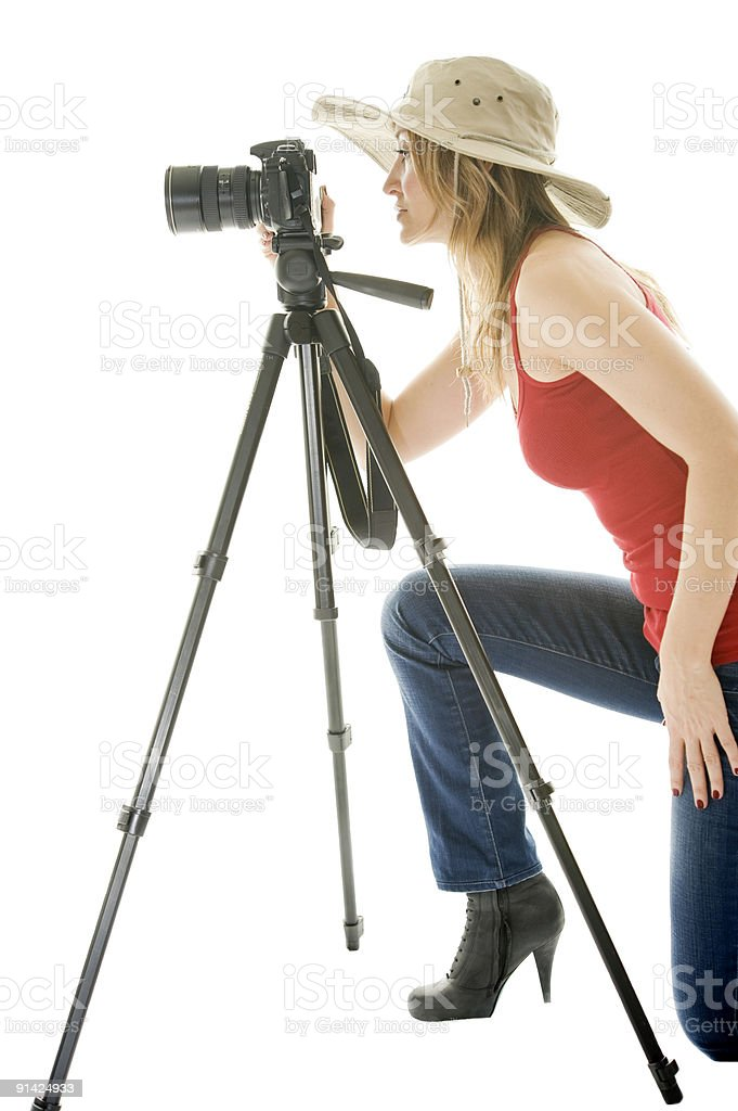Young beautiful woman with photo camera and tripod royalty-free stock photo
