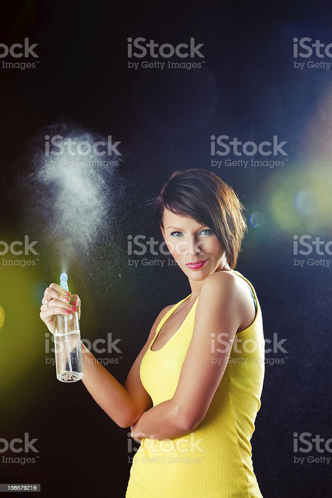Young beautiful woman with spray bottle stock photo