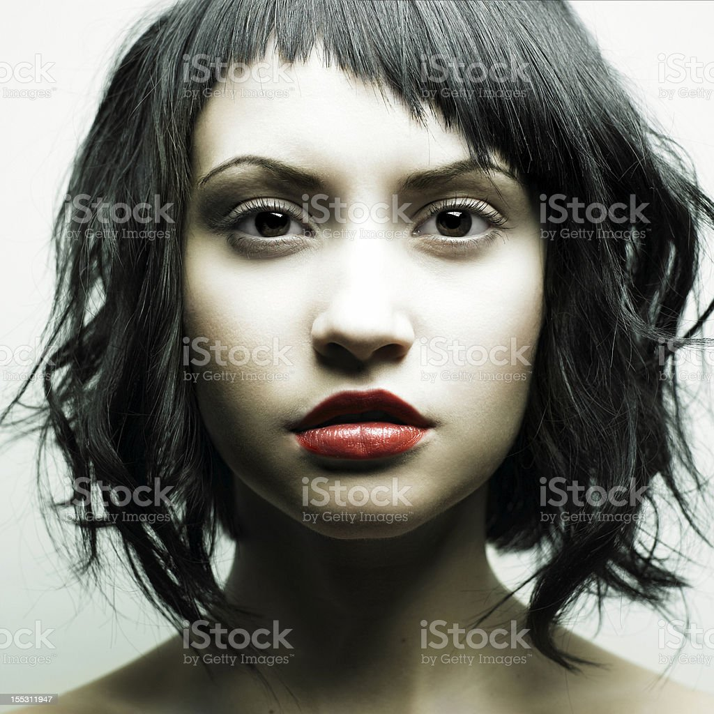 Young beautiful woman with strict hairstyle stock photo