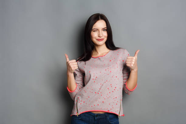 Young beautiful woman with thumb up portrait stock photo