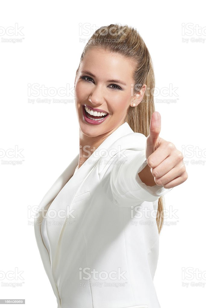 young beautiful woman with thumbs up on white royalty-free stock photo