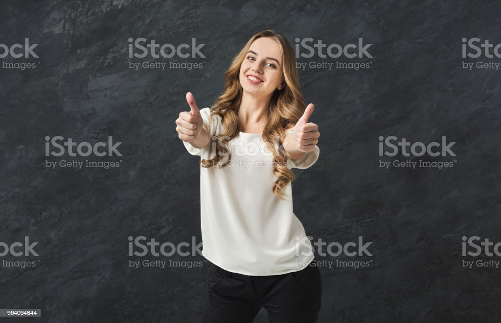 Young beautiful woman with thumbs up portrait - Royalty-free Adult Stock Photo