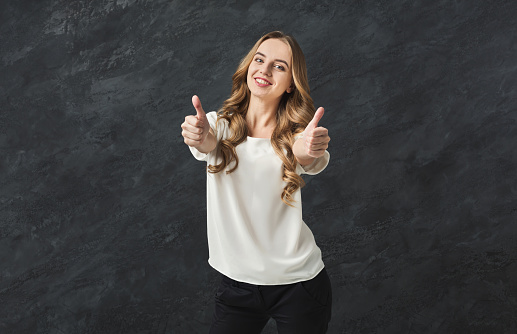 Young Beautiful Woman With Thumbs Up Portrait Stock Photo - Download Image Now