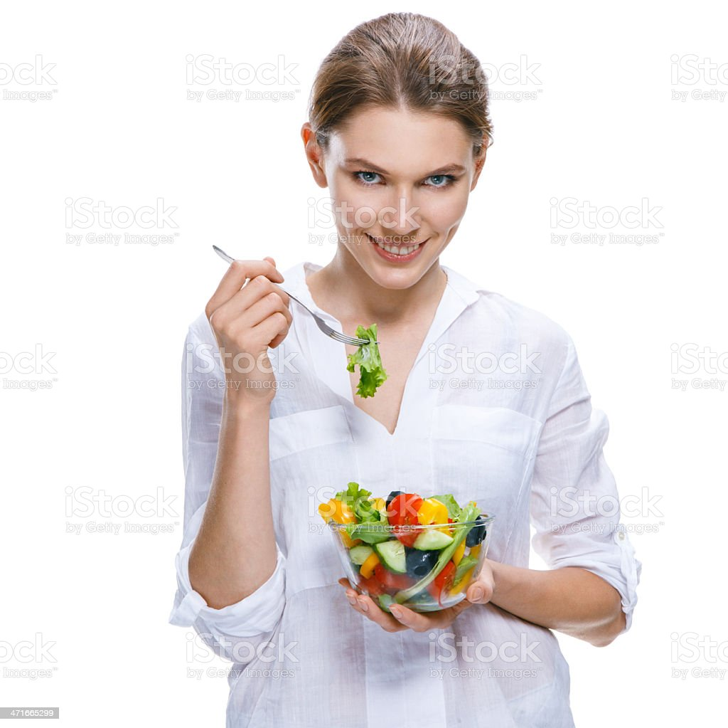 Young beautiful woman with vegetable salad bowl and fork stock photo